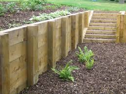 wooden retaining wall sloped garden