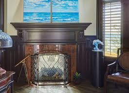 dark wood two sided fireplace with