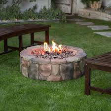 backyard patio deck stone fireplace