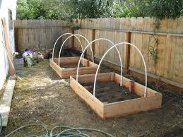 laid out plans for raised garden beds