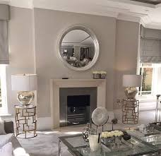 round mirrors over a fireplace