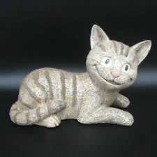 garden object statue cheshire cat