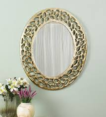 metal wall mirror in gold color by