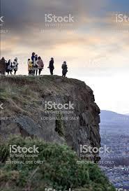 People On The Top Of Arthur Rock In Edinburgh In Uk Stock Photo ...