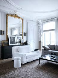wall mirror grey sofa white chair