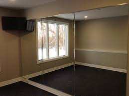 mirror wall in home gym other by