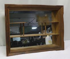 carved wood mirrored back shadow box