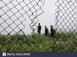 Hk Urbex Members Are Seen Through A Hole In The Fence At An Abandoned British Army Barracks In Hong Kong China June 1 2017 Reuters Tyrone Siu Search Siu Colonial For This Story