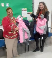 Donations at work — Twila Walker, left,... - Charles County Public ...