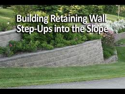 building retaining wall step ups into