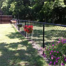 My Hanging Baskets On The Chain Link Fence Adding More Soon Chain Link Fence Backyard Fences Backyard Fence Decor