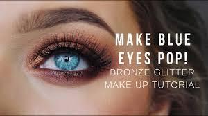 blue eyes pop bronze glitter make up