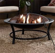 25 outdoor fire pits and accessories to