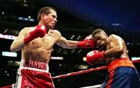Julio Cesar Chavez lands a left on Ivan Robinson. | Julio cesar ...