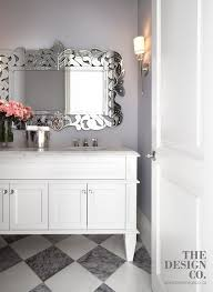 gray walls lined with a venetian vanity