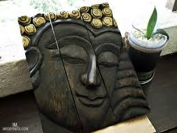 installing wooden buddha wall art