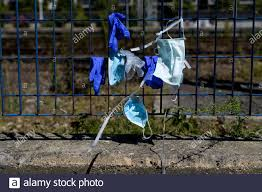 Group Of Used Masks And Gloves Placed By People On A Fence The Waste From Covid19 Selective Focus Stock Photo Alamy