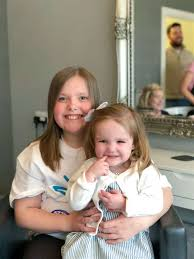 Invergordon lass gets the chop for plucky pal battling blood cancer
