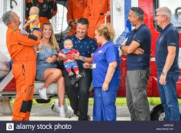 EMBARGOED TO 0001 FRIDAY AUGUST 16 Jennie and Rich Powell with their twin  boys Jenson, left, Ruben, right, who are celebrating their first birthday  by meeting HM Coastguard crews for the first