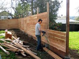 Building A Horizontal Plank Fence Backyard Fences Backyard Diy Privacy Fence