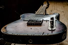 black and brown electric guitar old