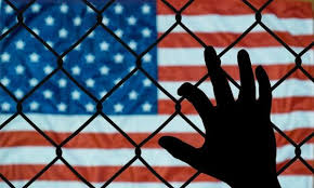 Usa Flag Behind Chain Link Fence News