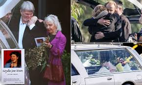Boyfriend of Eurydice Dixon hugs fellow mourners as a hundred people gather  to farewell the comedian | Daily Mail Online