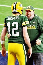 Green Bay Packers head coach MIKE McCARTHY discusses strategy with AARON  ROGERS - Gold Medal Impressions