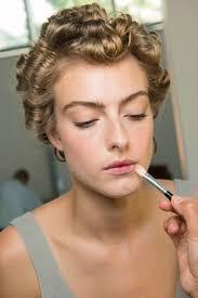 makeup artist at fashion week