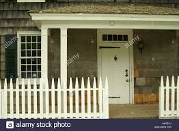 Colonial American House With White Picket Fence And Strap Hinges On Stock Photo Alamy