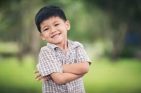 portrait of cute little boy standing