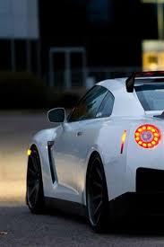 nissan gtr r35 white car at evening