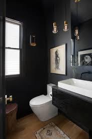 black powder room with brass pendant
