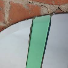 art deco oval wall mirror with green