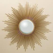 sunburst mirror with skewers espejos