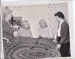 Sunie Penniman, Addie Rogers, Carrie Westgate, Margaret Rosa making a rug  1956 · Plainfield Historical Society