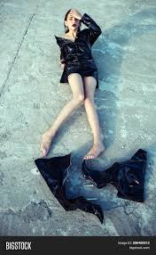 woman in black latex jacket barefoot