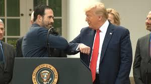handshake, offers elbow instead - CNN Video