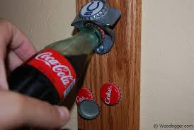 bottle opener with magnetic catch