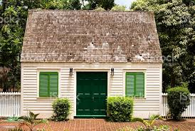 Small House With Brick Front Yard And White Picket Fence Stock Photo Download Image Now Istock