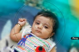 indian cute baby boy lying on bed