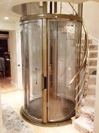 round glass elevator bronze citi