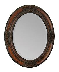 oval mirror in cherry wood finish