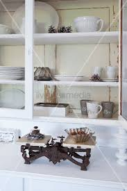 old kitchen scales and white crockery