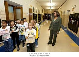 Detroit, Michigan - First grade teacher Ivy Bailey monitors girls in the  hallway at MacDowell..., Stock Photo, Picture And Rights Managed Image.  Pic. X2J-1065242 | agefotostock