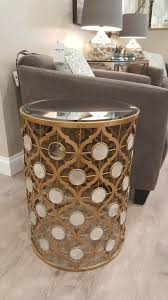 gold cylindrical mirror table