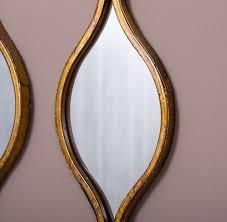 set of 3 tall ripple gold wall mirrors