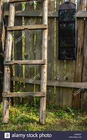 Portable Folding Solar Battery Panel Hangs On A Wooden Fence Nearby There Is A The Ladder Outdoors In The Countryside Stock Photo Alamy