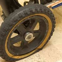 Worn mobility scooter tire of 2-seater