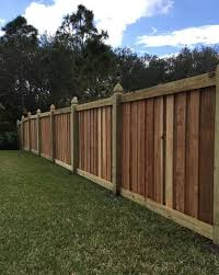 Capped Board On Board Wood Privacy Fence With Gothic Posts Fence Design Installation By Mossy Oak Fence Orlan Fence Design Wood Fence Design Wood Fence